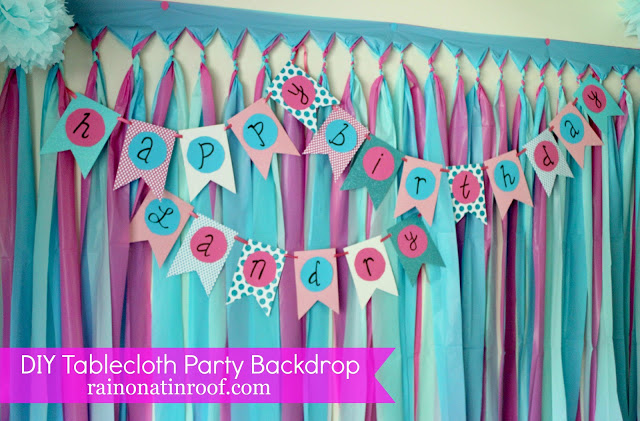 diy birthday banner tutorial with paper scissors and a marker