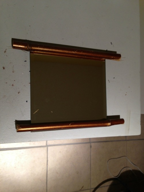 DIY Bamboo Mirror {rainonatinroof.com} #trashtotreasure #bamboo #mirror