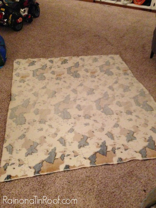DIY Cowhide Rug (No Painting Required!) via RainonaTinRoof.com #diy #cowhide #rug