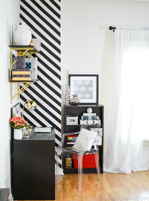 Looking for BIG bang for your buck? Here are 9 Accent Walls for $30 or Less - includes lots of wall painting ideas, techniques and designs - and they are all DIY projects! Great painting ideas including this black and white striped wall!