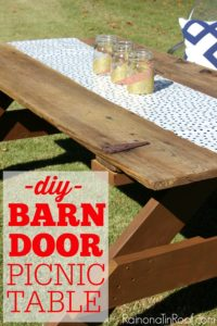 This is so cool - just add legs to an old barn door and you have an instant picnic table! How to Build a Picnic Table out of a Barn Door via RainonaTinRoof.com