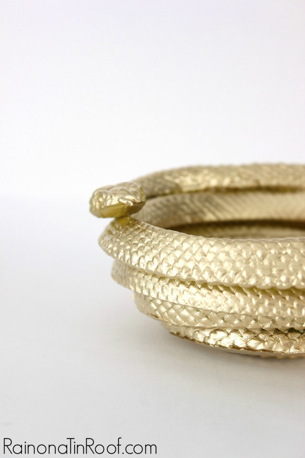 Had no clue you could do something like this with a heat gun! So many possibilities! DIY Gold Snake Bowl via RainonaTinRoof.com