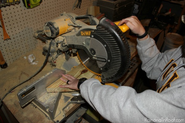 Making a cut with a miter saw - Rain on a Tin Roof