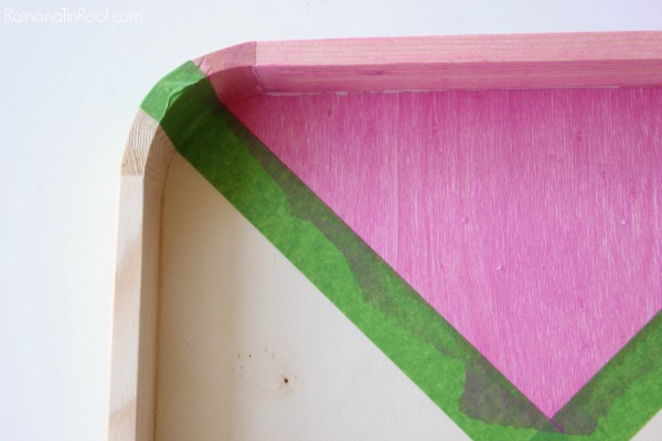 Applying DIY pink colored stain.