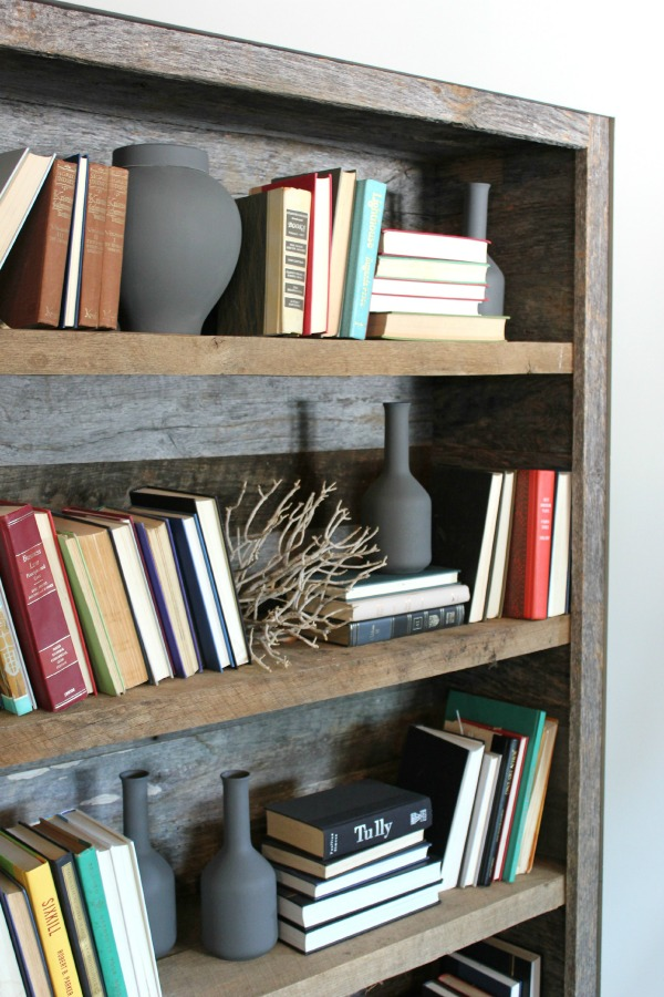 Cover a bookshelf in barn wood or pallet wood.