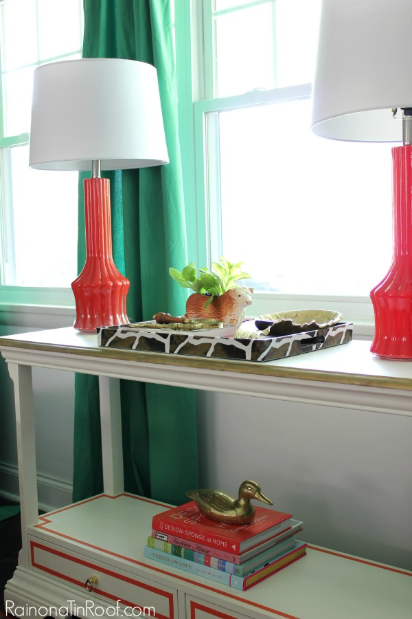 Modern Living Room - love the kelly green curtains against the coral lamps!