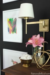 Sconces on a gallery wall. Summer Home Tour: The details make the space.