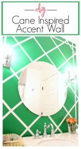 DIY Cane Inspired Accent Wall done for around $25. Gorgeous kelly green wall treatment in this bathroom.