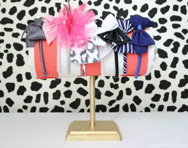 DIY Headband Holder - Full tutorial on how to make this cute addition to a little girl's room for only $5. No sewing required!