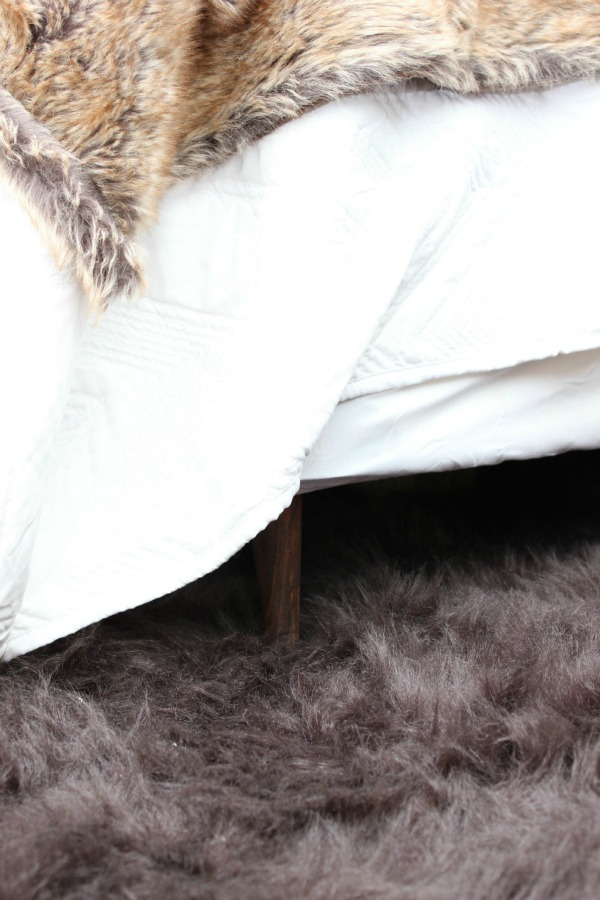 How to Add Feet to a Box Spring and Get Rid of the Footboard - great and easy idea for small bedrooms. You could also remove the headboard with this idea if you wanted to. / Bedroom Ideas / DIY Bed Ideas / DIY Bed Frame