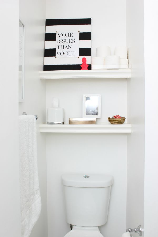 White Built-in Bookshelves over Toilet - can make for about $25 |Spring Home Tour: The Evolution of Style | White Bathroom Makeover with a Pop of Green