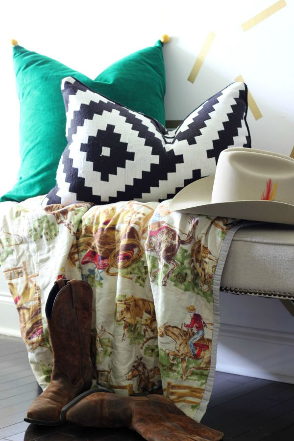 Decorating with Green: Green pillow paired with black and white graphic pillow and vintage cowboy blanket against a fun and modern confetti wall treatment.