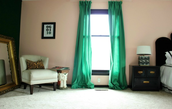 Well Traveled Master Bedroom Makeover Reveal - DO NOT miss this master bedroom! It combines bold black and white, a touch of green, pink and a dash of Palm Beach! STUNNING! Lots of great DIY project ideas for bedrooms in this article! Features DIY Lucite / Acrylic curtain rods and lots of other great DIY project ideas for bedrooms!