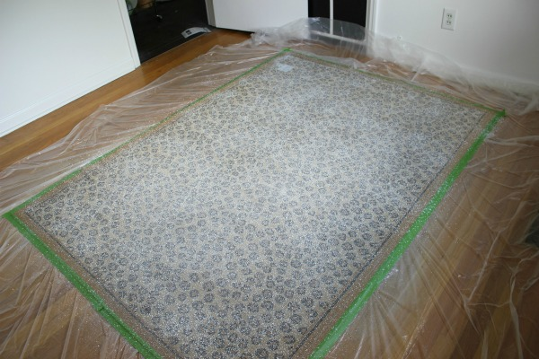 How to Keep Rugs from Sliding: Spray on this stuff and they won't budge a bit!