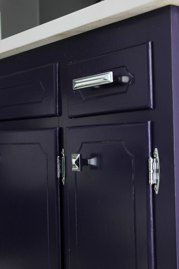 Such an adorable bathroom for a kid, but also stylish for adults! The 70's Landing Pad Hall Bathroom Remodel   Gray Walls / Kid's Bathroom / Purple Bathroom Vanity / Chrome Hardware