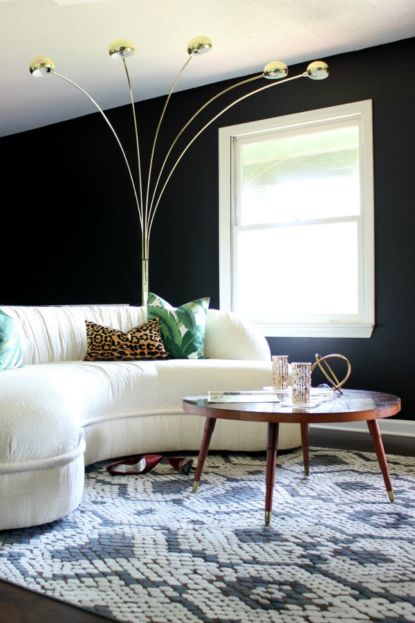 JAW DROPPING! The 70's Landing Pad Living Room Tour: Full of vintage finds paired with modern pieces and pops of color. Living Room Design | Black and White Interior Decorating | Vintage Decor | Retro Decor