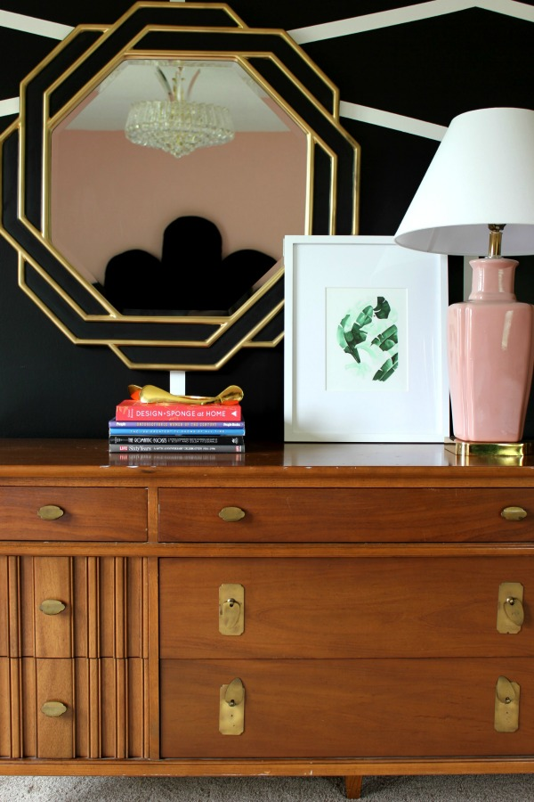 This master bedroom makeover is a MUST-SEE! Who knew pink could look so good?! It's an eclectic vibe of old Hollywood glamour meets Palm Beach decorating styles! The 70's Landing Pad Home Tour, Part 2: The Master Bedroom | DIY Black and White Accent Wall | Mix of Modern and Vintage Design Styles