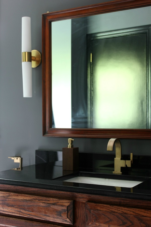 This bathroom remodel is gorgeous  It s a great combination of masculine  and feminine design perfectly. Black  Gray and Brass Master Bathroom Remodel