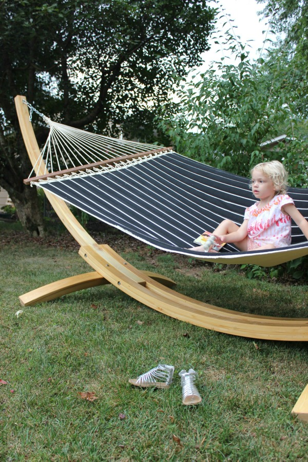 Here's to hills, hammocks, and sweet memories. | DFO Home Black and White Striped Hammock and Wooden Arc Hammock Stand