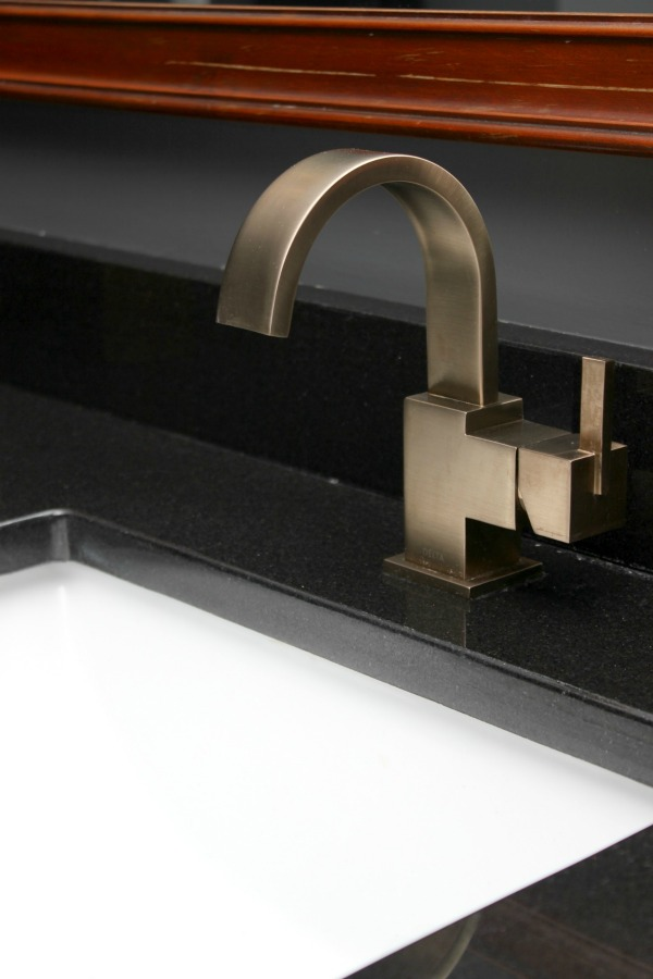 Vero Faucet in Champagne Bronze on Black Granite - Rain on a Tin Roof