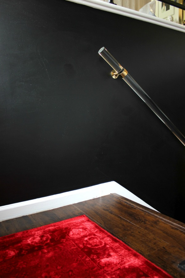 If you love black walls and dramatic interior design, you have to see this entryway makeover! It's full of deep moody colors and breathtaking art! Dramatic Entryway Makeover | DIY Lucite Handrail| Black Walls | Dramatic Red Rug
