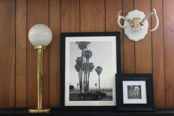 Five Ways to Decorate a Room with Wood Paneling and Make It Look Good | These are really great ideas to save some money and to help you learn to love your wood paneling! | Den | Jungle Room | 70's Inspired Interior Design | Vintage Palm Art | Decorating above a Couch