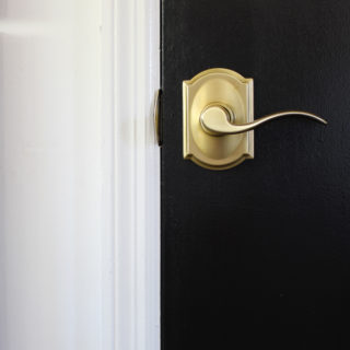 Door Upgrade in a Day: Black Doors, White Trim, and Brass Hardware