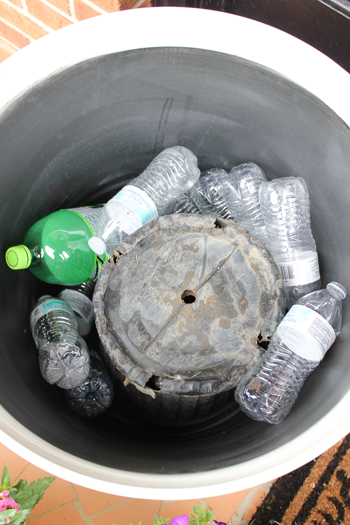Tips for Beautiful Planters All Summer Long - fill the bottom of your planters with plastic bottles to help drainage and reduce the amount of soil you need.