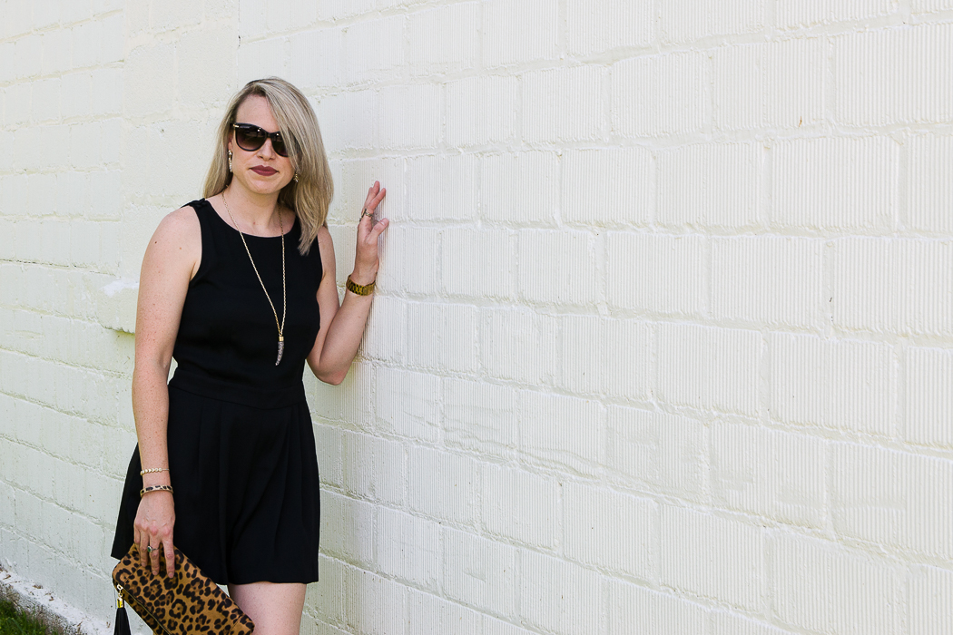 Effortless Outfits: Rompers | Black Romper with Red Sandals and Leopard Clutch - a dressy romper outfit.