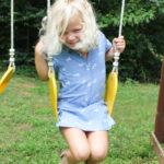 Summer Fun on the Swing in a Hatley Horse Dress