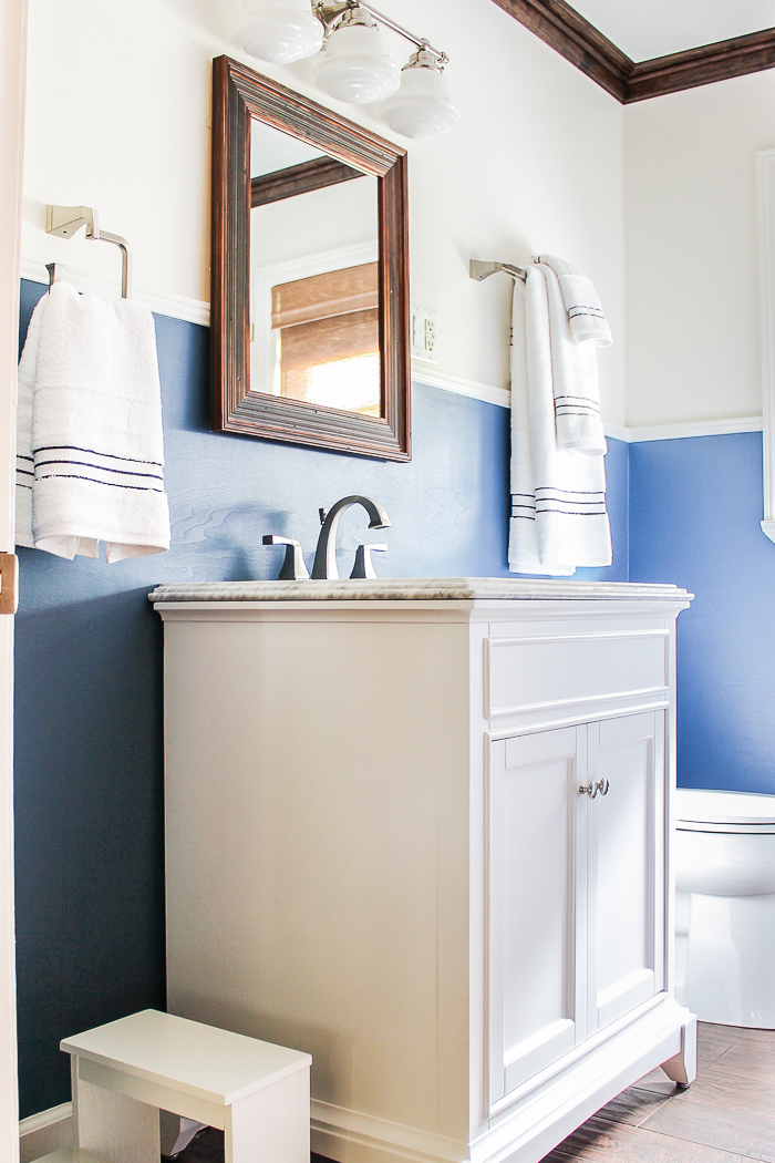 A traditional nautical farmhouse bathroom renovation that has a touch of farmhouse style mixed with a traditional and nautical feel.