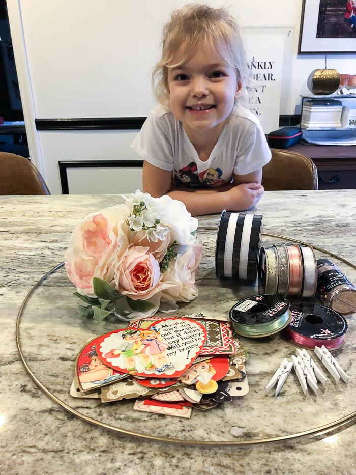 Supplies for making a valentine door wreath.