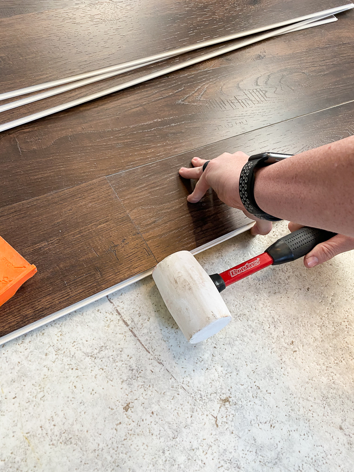 Tapping in vinyl plank flooring from Sam's Club.