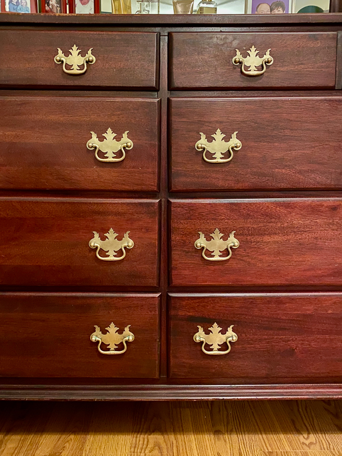 How to Restore Wood Furniture Without Sanding - restored mahogany dresser and brass pulls.