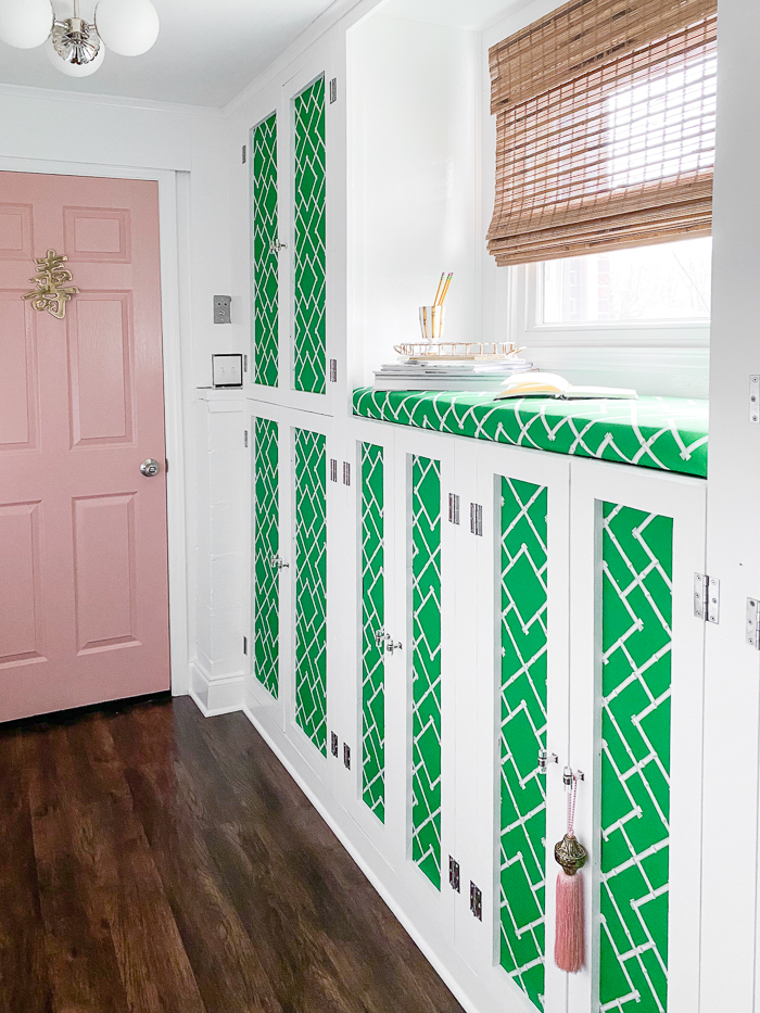 Colorful mudroom cabinets with decorative fabric panels.