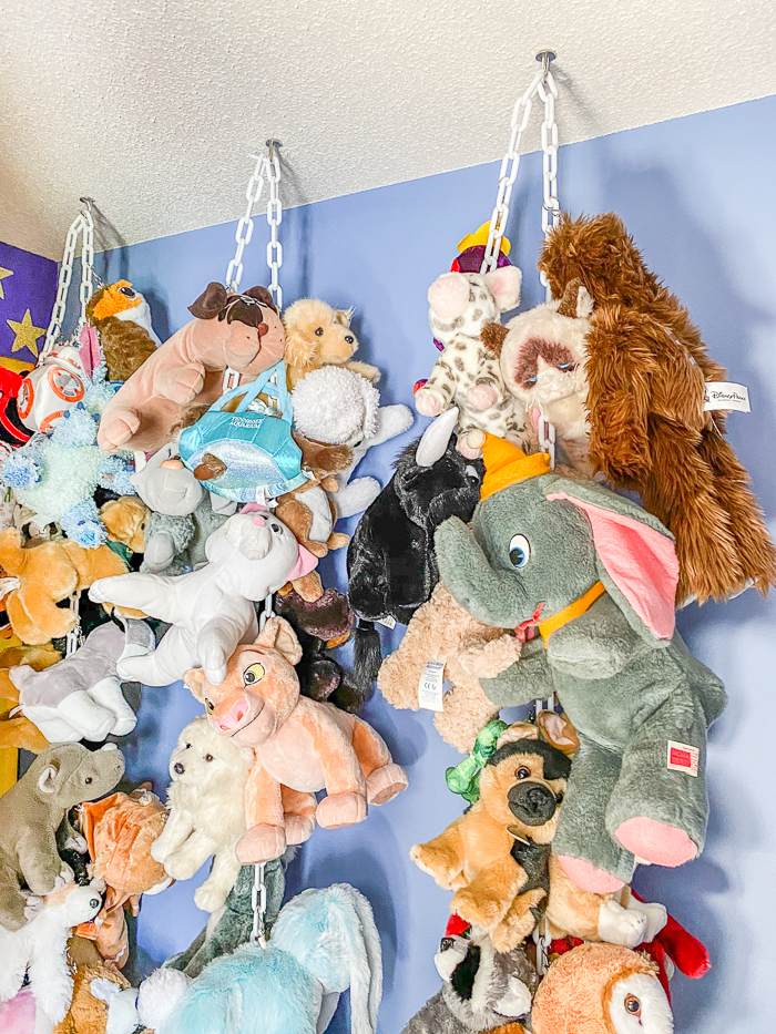 stuffed animal storage ideas- hanging chain from the ceiling and hanging animals from clip hooks