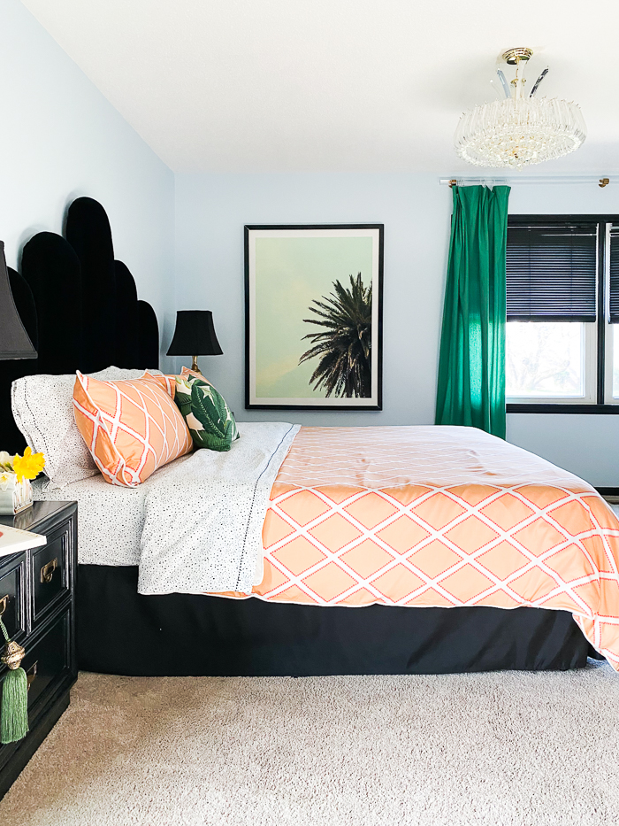 Blue Bedroom with Orange Bedding, Green and Black and White Accents