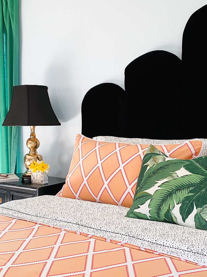 Orange bedding with black and white sheets.